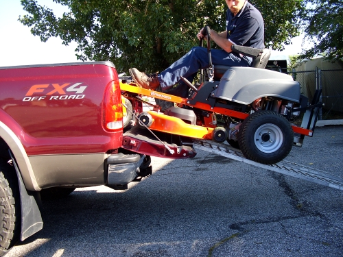 Mackie using Rider Tailgate Lowering Links to load a Husqvarna Mower